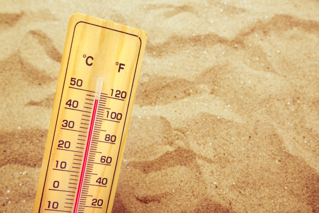 Extremely high temperatures, thermometer on warm desert sand